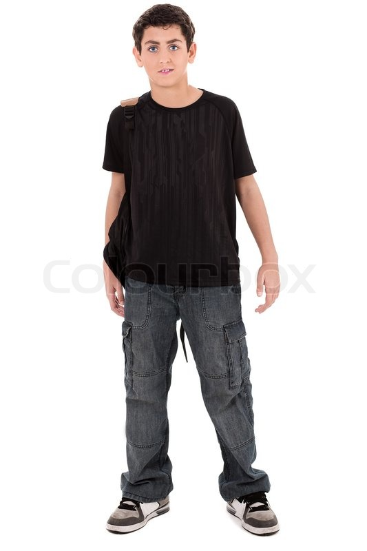 Teenage school boy standing on isolated white background ...