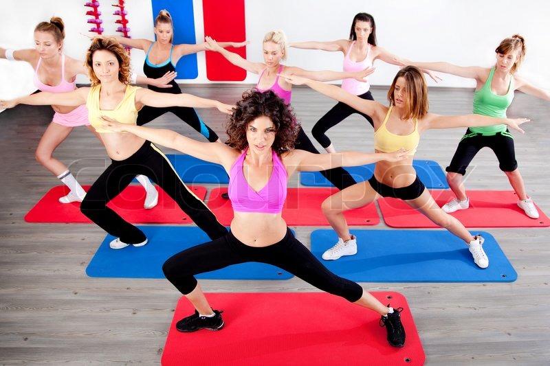 image of women doing streching in aerobic class stock photo