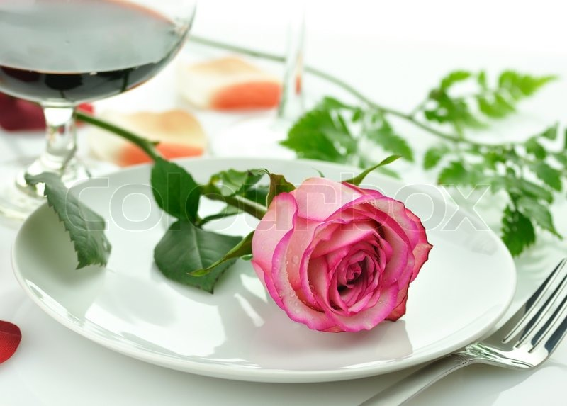 & Romantic dinner with rose on a plate | Stock Photo | Colourbox