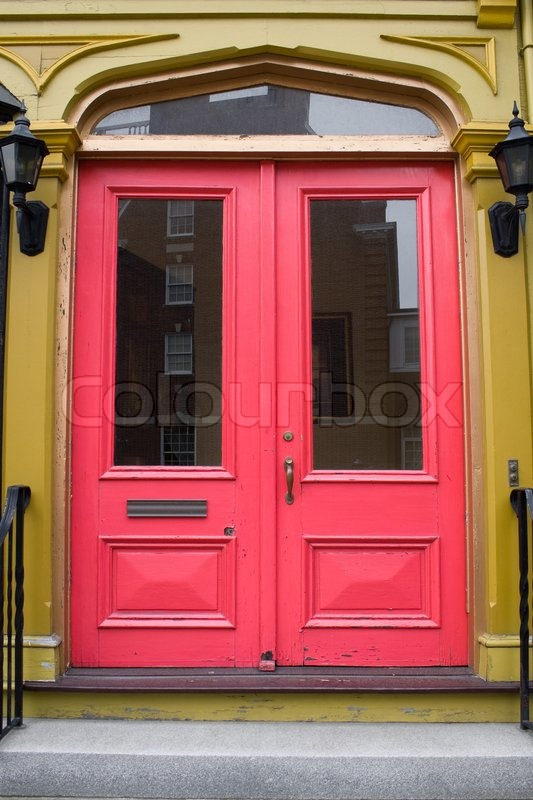 An Antique Doorway With Red Painted Doors Stock Photo