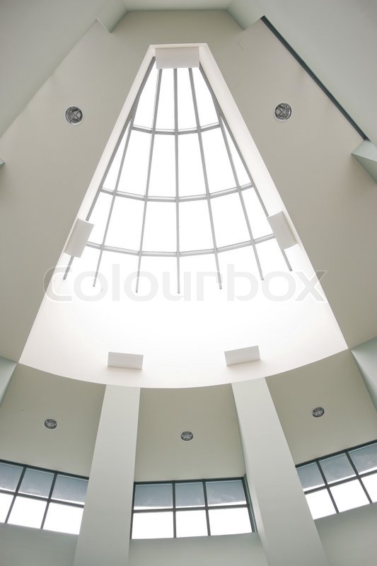 A modern architectural interior with a triangular shaped for Architectural skylights