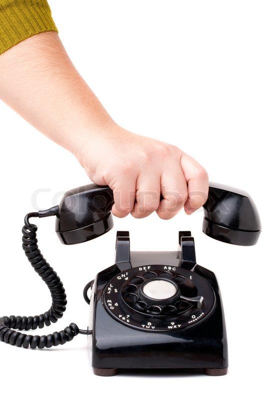 auflegen des h rers eines alten schwarzen vintage dreh stil telefon isoliert ber wei. Black Bedroom Furniture Sets. Home Design Ideas
