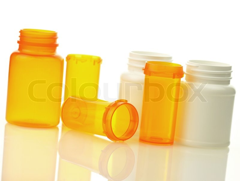 Empty pill bottles on white background stock photo for What to do with empty prescription bottles