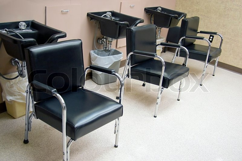 Hair Salon A Row Of Hair Washing Sinks And Chairs