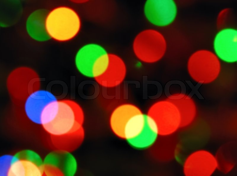 color photo of blurred christmas lights at night stock photo