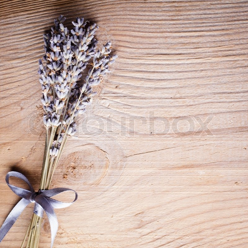 wooden table close up. lavender bunch on the wooden table closeup, stock photo close up