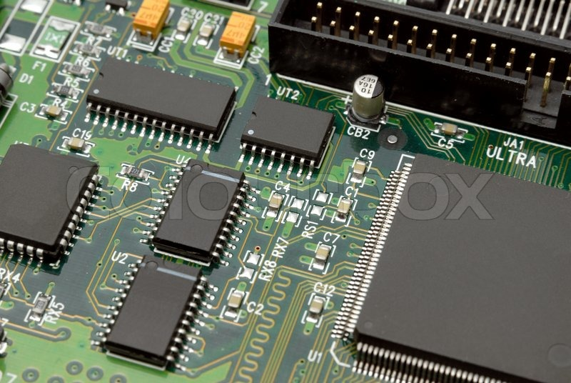 The printed-circuit-board with computer chips resistors and