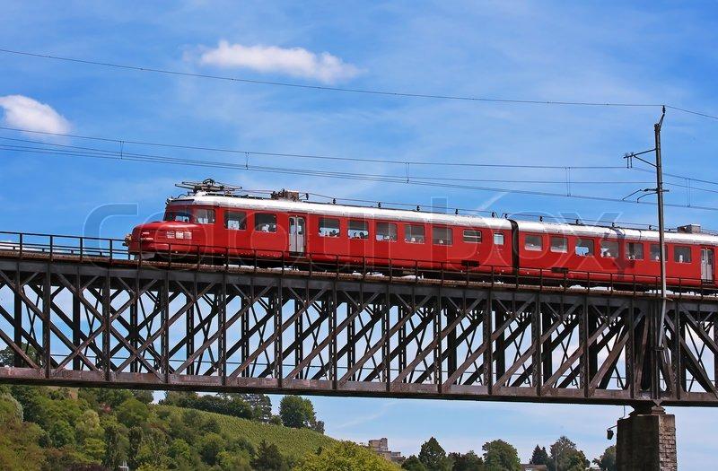Old Swiss Train On The Bridge Over Rhine River Stock Photo - Swiss river to the rhine