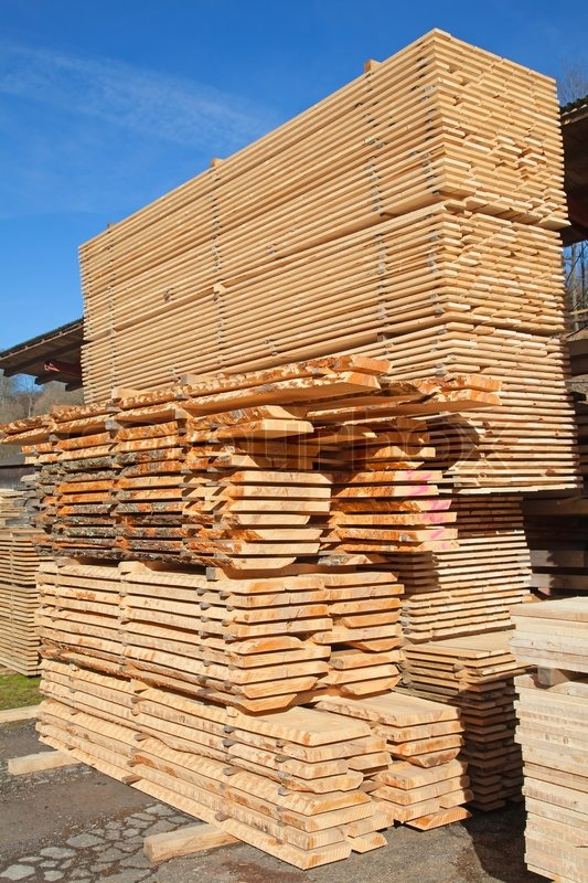 Stack of new wooden studs at the lumber yard stock photo