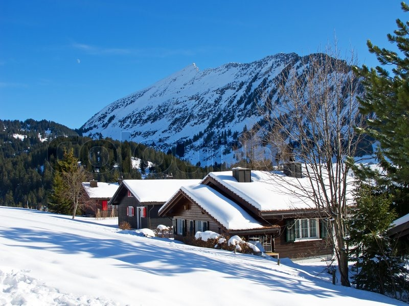 Winter Holiday House In Swiss Alps Stock Photo Colourbox