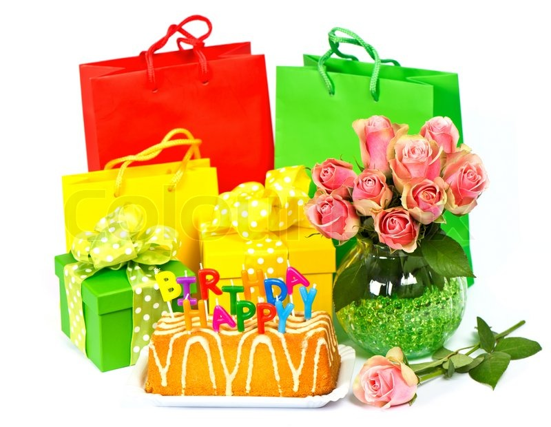 Stock image of Happy Birthday! cake with candles, flowers and gifts ...