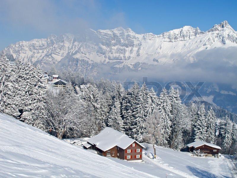 winter ferienhaus in schweizer alpen stockfoto colourbox. Black Bedroom Furniture Sets. Home Design Ideas