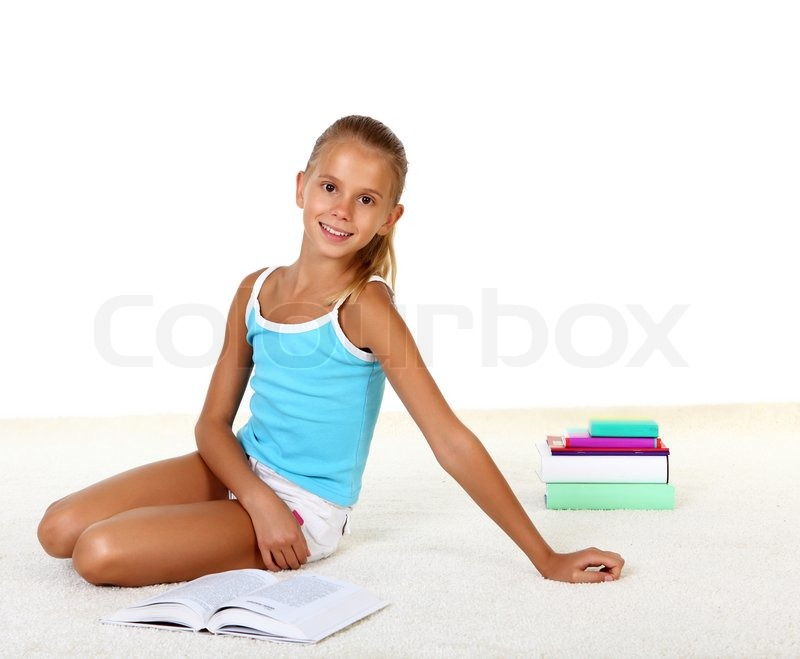Pretty Teenage Girl Sitting On Th Efloor With Study Books