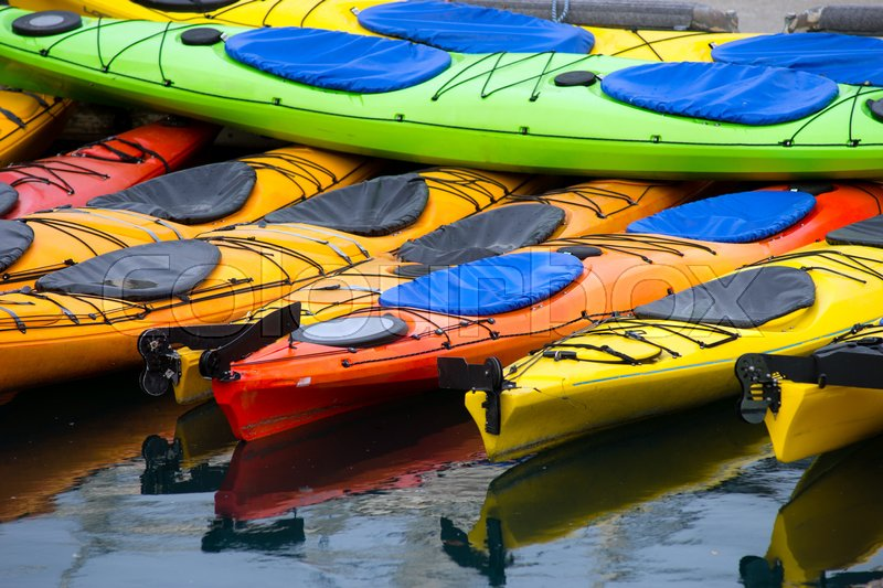 Kayaks wait for the next traveler to pay for a rental, stock photo