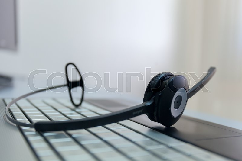 Computer headphones on a keyboard of the notebook stock photo no man, stock photo