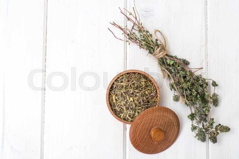 Dried and crushed thyme spice in cooking. Studio Photo , stock photo