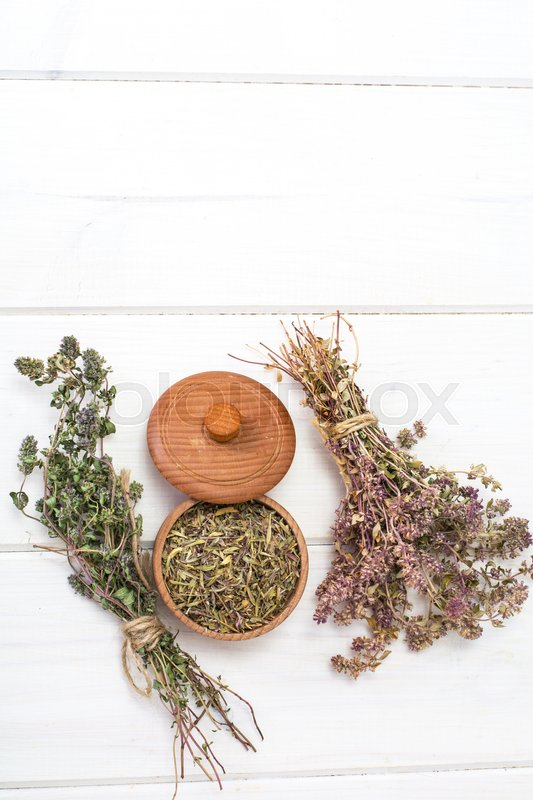 Dried and crushed thyme spice in cooking. Studio Photo \, stock photo