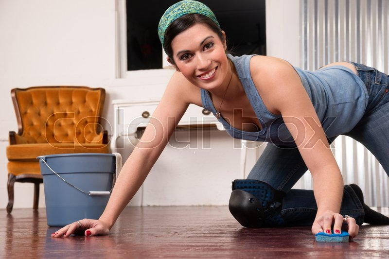 Adorable Housewife Doing Cleaning Chores Scrubbing Wood Floor Hands