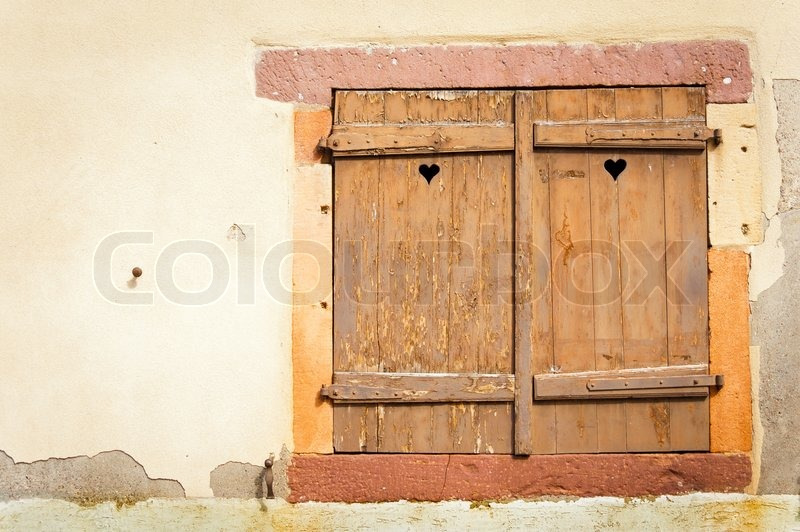 Rustic Window With Wooden Shutters Stock Photo Colourbox