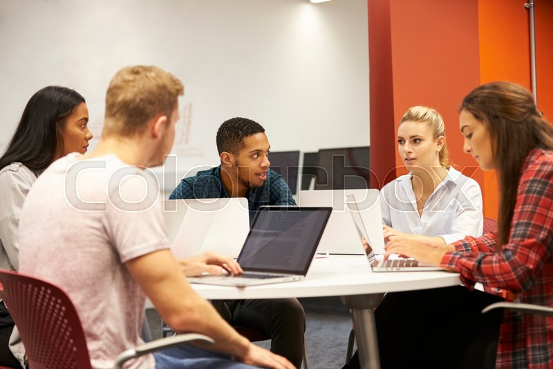 Group Of University Students Collaborating On Project, stock photo
