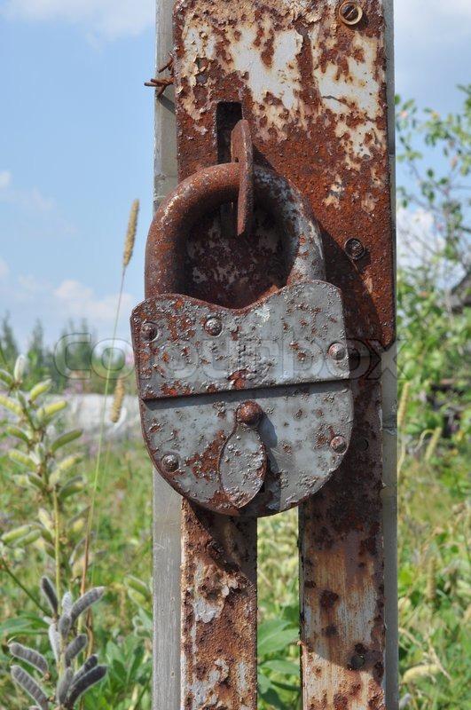 Rusty Padlock On An Old Broken Gate Abandoned Farmhouse