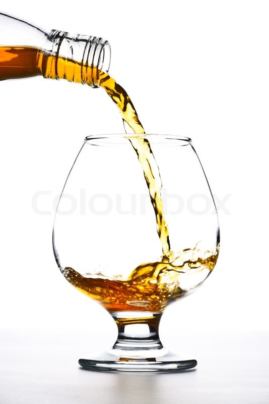 cognac pour into the glass over white stock photo colourbox