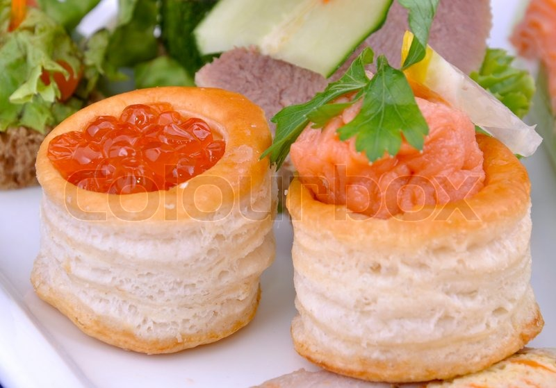 Canape with salmon caviar and pate of salmon on a plate for Canape with caviar