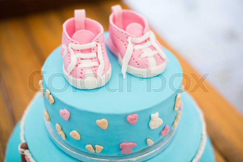 Child birthday cake Decorated for kids Blue color with pink shoes