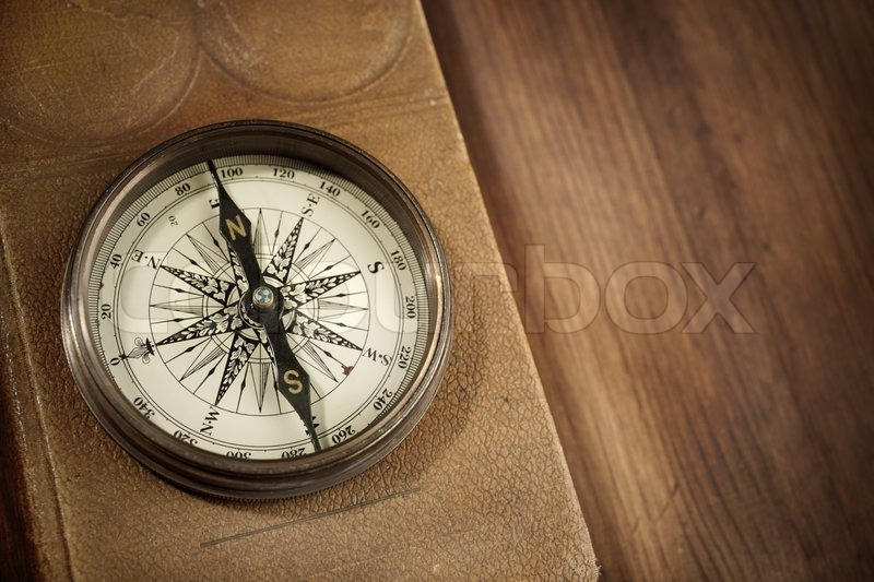 Vintage Concept With Old Compass And Atlas On Wooden