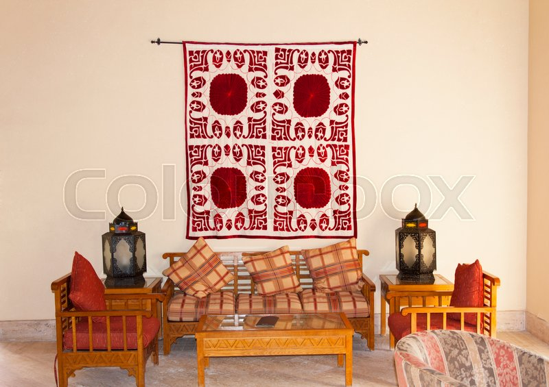 Vintage turkish arabian or indian lantern interior. Pillow on sofa ...