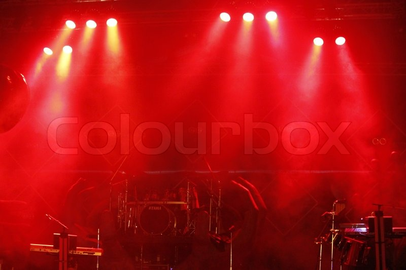Red stage light at outdoor concert, stock photo