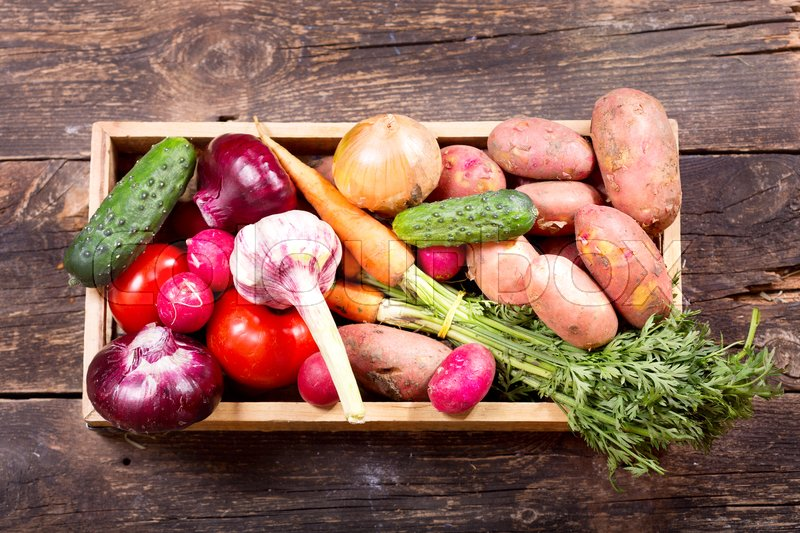 Stock image of 'fresh vegetables in wooden box on wooden background'