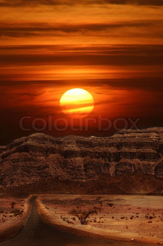 vertical oriented image of sunset over the mountains of. Black Bedroom Furniture Sets. Home Design Ideas