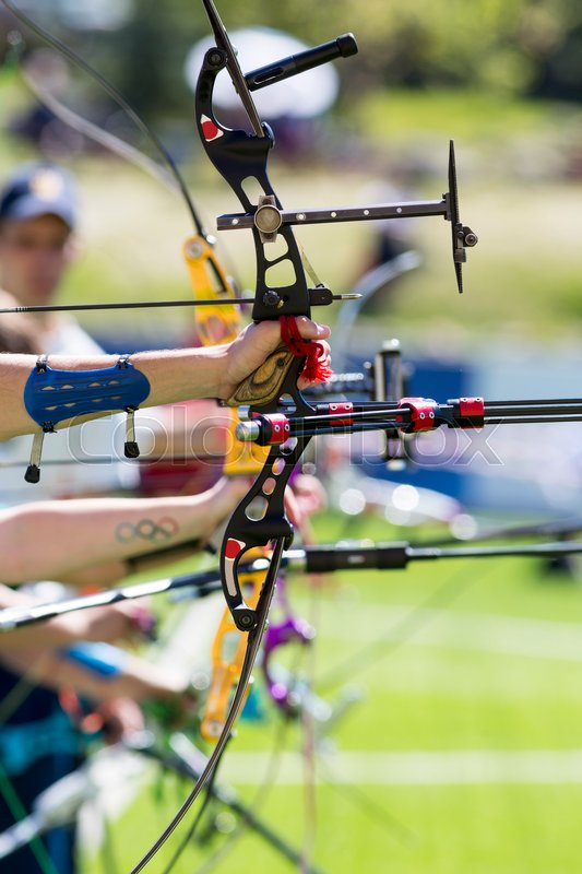 People Are Shooting With Recurve Bows During An Archery Competition