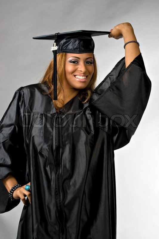 A hispanic girl at graduation posing in her cap and gown isolated ...