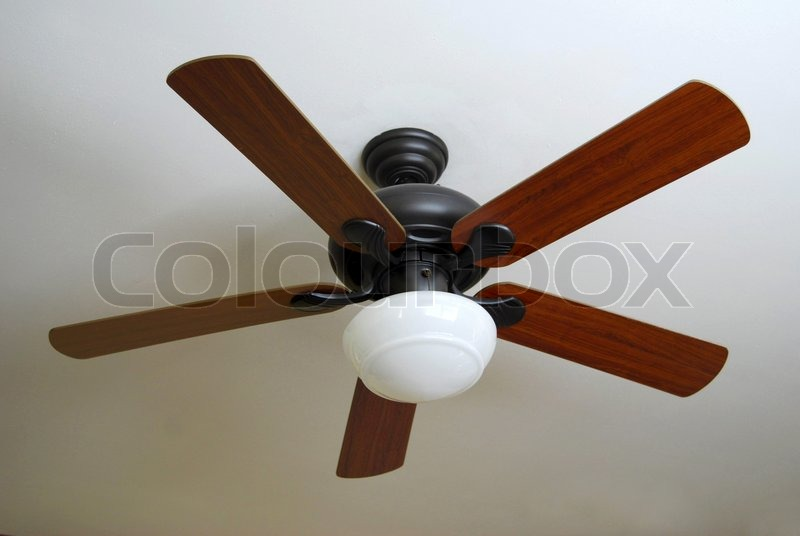 A modern ceiling fan installed on a textured white ceiling stock a modern ceiling fan installed on a textured white ceiling stock photo colourbox aloadofball Images