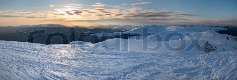 Beautiful mountain sunset landscape with sun way on ice-coated mountainside (Ukraine, Carpathian Mt\'s, Svydovets Range) Three shots stitch image, stock photo