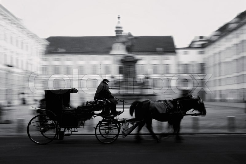 Horse driven carriage at hofburg palace in vienna austria black white stock photo