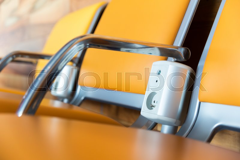 Yellow chairs with electric outlet in airport waiting hall. Suitable for bus, railway, metro station. , stock photo