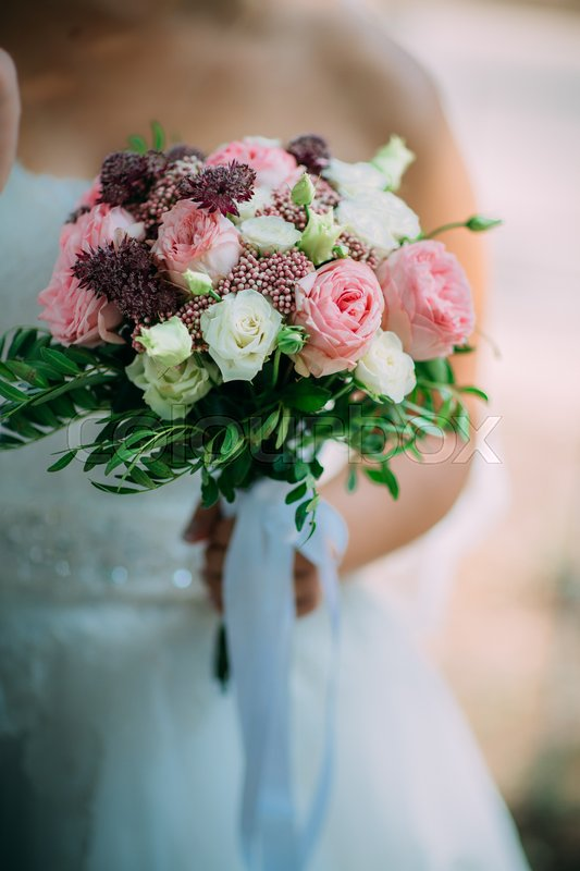 Stock image of 'fresh bridal bouquet of roses of different colors.'