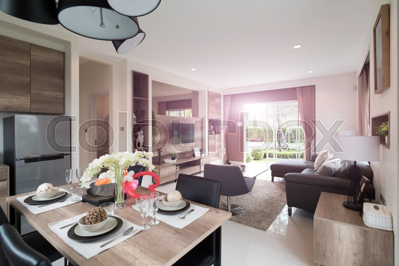 Beautiful room interior with hardwood floors and view of new luxury home, stock photo