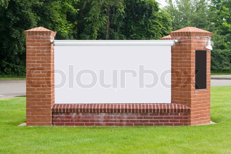 A Blank Sign With Brick Pillars Found Stock Photo