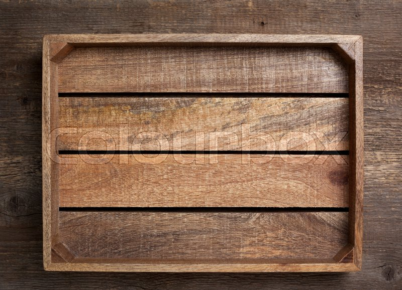 Empty wooden box on old wooden background (top view, dark), stock photo