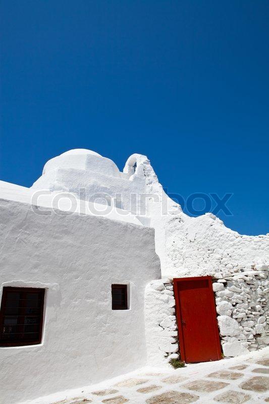 Blue Sky White Building Red Door In Stock Photo