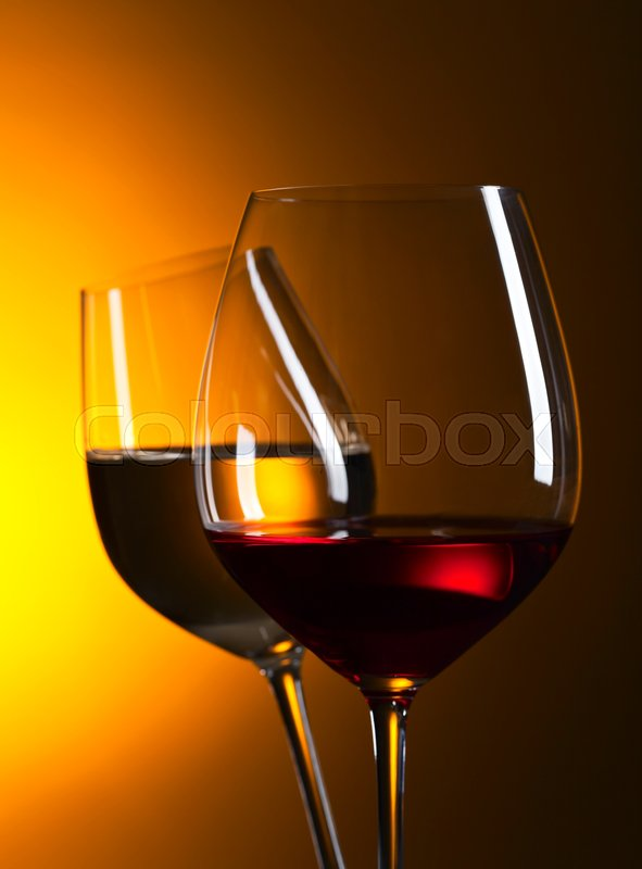 Closeup of glasses with red and white wine, stock photo