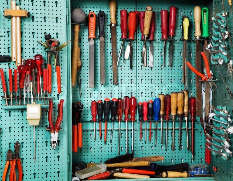 schrank mit werkzeug in einer werkstatt ausstattung eines handwerksbetrieb stockfoto colourbox. Black Bedroom Furniture Sets. Home Design Ideas