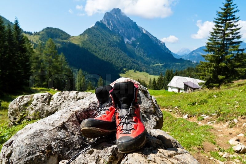 red hiking boots on a hike in the mountains of austria. Black Bedroom Furniture Sets. Home Design Ideas