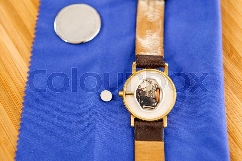 Stock image of 'Rear view of a watch with the procedure of changing of battery cell '