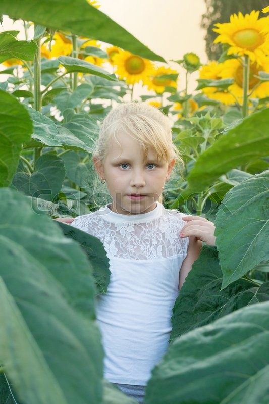 The photo shows a girl with flowers sunflower, stock photo