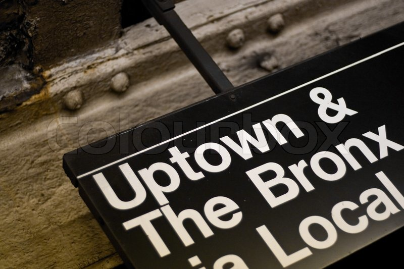 A New York City Subway Sign Pointing To Uptown And The